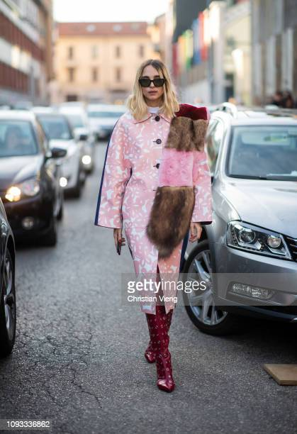 Candela Novembre is seen wearing fake fur scarf over shoulder pink coat with print bordeaux boots outside Marni during Milan Menswear Fashion Week...