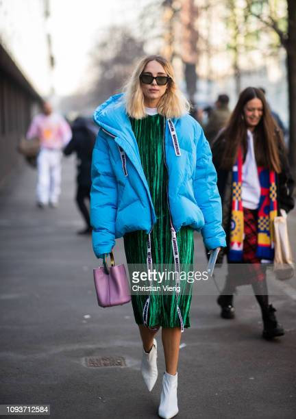 Candela Novembre is seen wearing green dress baby blue down feather coat white boots pink bucket bag outside Sunnei during Milan Menswear Fashion...