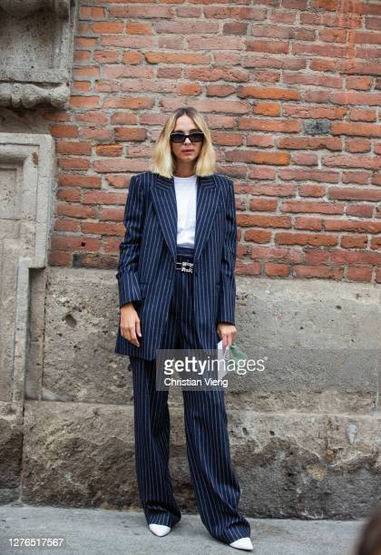 Candela Novembre is seen wearing navy stripped blazer and pants outside Max Mara during the Milan Women's Fashion Week on September 24, 2020 in...
