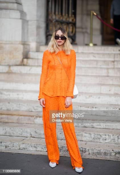 Candela Novembre is seen wearing orange pants top outside Stella McCartney during Paris Fashion Week Womenswear Fall/Winter 2019/2020 on March 04...