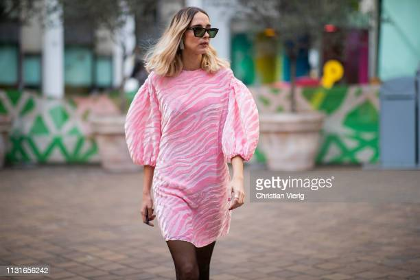 Candela Novembre is seen wearing pink jacket outside Vivetta on Day 2 Milan Fashion Week Autumn/Winter 2019/20 on February 21 2019 in Milan Italy