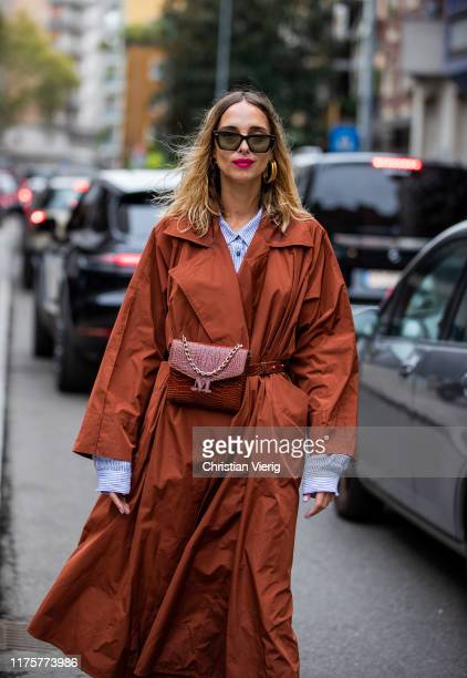 Candela Novembre is seen wearing rusty brown trench coat, belt bag, blue button shirt outside the Max Mara show during Milan Fashion Week...