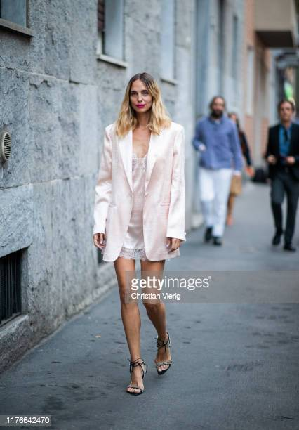 Candela Novembre is seen wearing silk pink blazer laced top outside the Missoni show during Milan Fashion Week Spring/Summer 2020 on September 21...