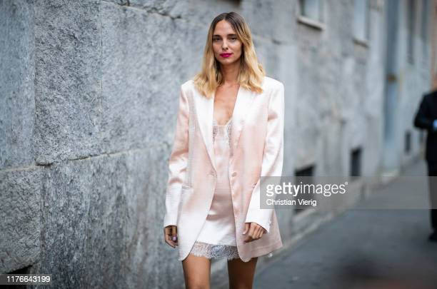 Candela Novembre is seen wearing silk pink blazer, laced top outside the Missoni show during Milan Fashion Week Spring/Summer 2020 on September 21,...