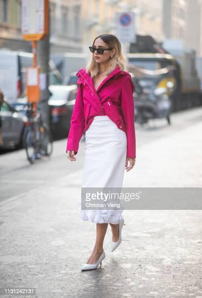 Candela Novembre is seen wearing white ruffled skirt pink asymmetric zipped jacket outside Max Mara on Day 2 Milan Fashion Week Autumn/Winter 2019/20...