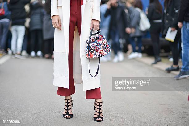 Candela Novembre poses wearing Fendi before the Fendi show during the Milan Fashion Week Fall/Winter 2016/17 on February 25 2016 in Milan Italy