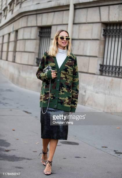 Candela Novembre seen wearing camouflage bag and cardigan, black skirt outside Miu Miu during Paris Fashion Week Womenswear Spring Summer 2020 on...