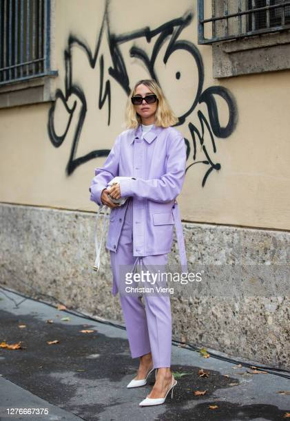 Candela Novembre seen wearing pink pants and jacket, white bag outside Boss during the Milan Women's Fashion Week on September 25, 2020 in Milan,...