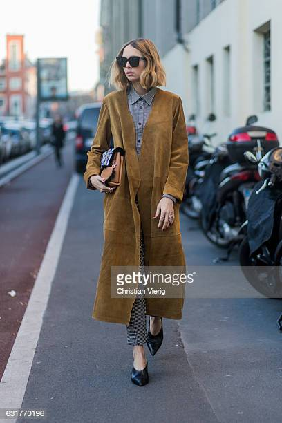 Candela Novembre wearing a beige brown coat during Milan Men's Fashion Week Fall/Winter 2017/18 at Missoni on January 15 2017 in Milan Italy