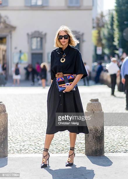 Candela Novembre wearing a black button shirt and skirt outside Blumarine during Milan Fashion Week Spring/Summer 2017 on September 24 2016 in Milan...