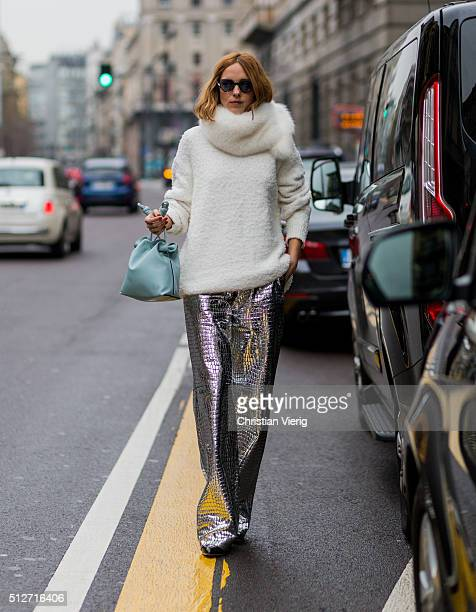 Candela Novembre wearing a creme sweater and fur scarf and a silver pants seen outside Blumarine during Milan Fashion Week Fall/Winter 2016/17 on...