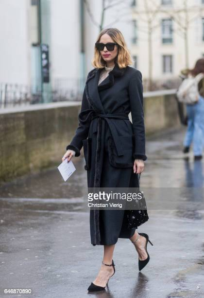 Candela Novembre wearing a navy coat outside Rochas on March 1 2017 in Paris France