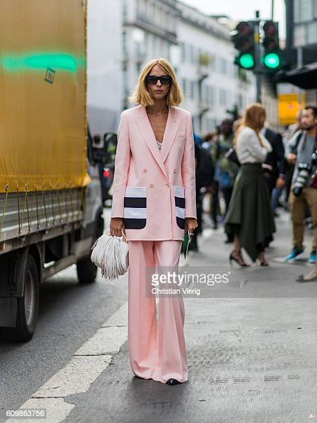 Candela Novembre wearing a pink suit outside Max Mara during Milan Fashion Week Spring/Summer 2017 on September 22 2016 in Milan Italy