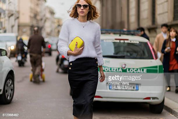 Candela Novembre wearing a white Fendi sweater a yellow Stella McCartney clutch a black Max Mara skirt seen outside Max Mara during Milan Fashion...