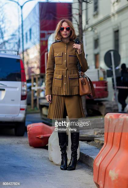 Candela Novembre wearing Marco de Vincenzo and Stuart Weitzman boots outside at No21 during Milan Men's Fashion Week Fall/Winter 2016/17 on January...