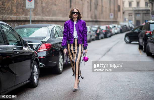 Candela Novembre wearing purple bomber jacket stripped skirt seen outside Max Mara during Milan Fashion Week Fall/Winter 2018/19 on February 22 2018...