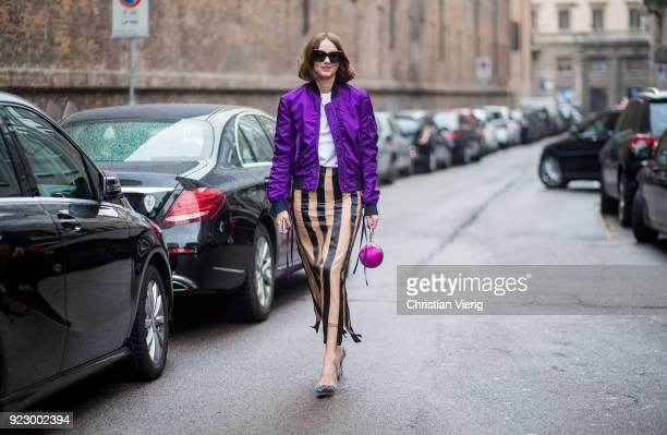 Candela Novembre wearing purple bomber jacket stripped skirt seen outside Max Mara during Milan Fashion Week Fall/Winter 2018/19 on February 22 2018...
