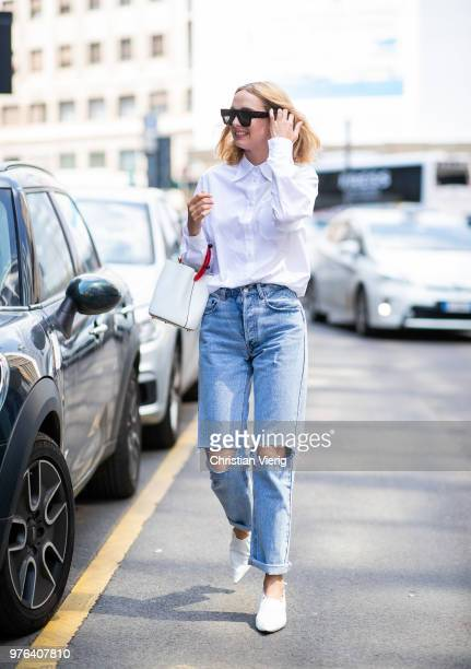 Candela Novembre wearing ripped denim jeans white button shirt white bucket bag is seen outside Marni during Milan Men's Fashion Week Spring/Summer...