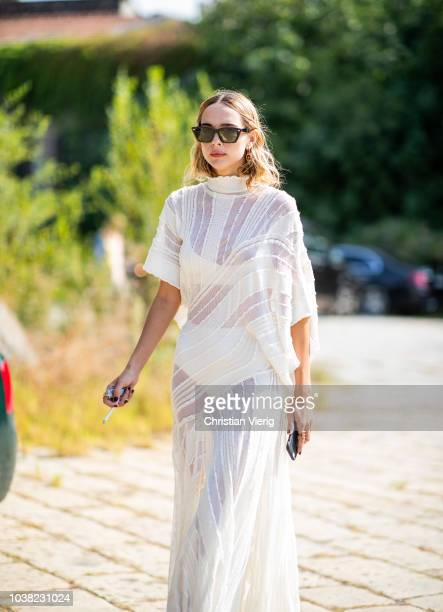 Candela Novembre wearing white sheer dress is seen outside Roberto Cavalli during Milan Fashion Week Spring/Summer 2019 on September 22 2018 in Milan...