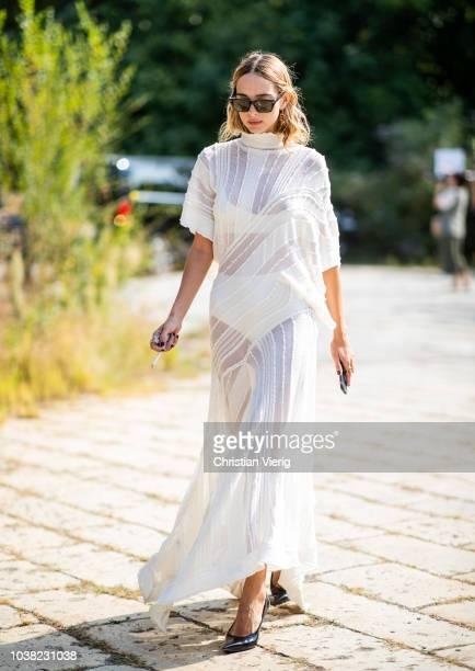 Candela Novembre wearing white sheer dress is seen outside Roberto Cavalli during Milan Fashion Week Spring/Summer 2019 on September 22 2018 in Milan...