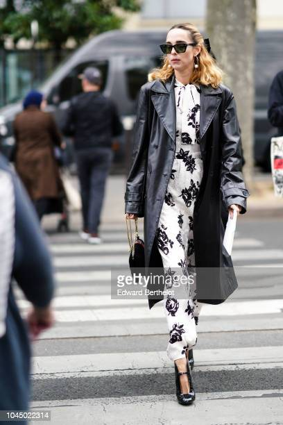 Candela Novembre wears a black leather jacket a white dress with black floral print sunglasses outside Miu Miu during Paris Fashion Week Womenswear...