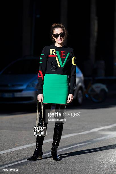 Candela Novembre wears a black Loewe leather jacket gray and black striped Costume National suit white sunglasses a pink Loewe puzzle purse and black...