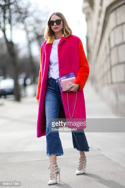 Candela Novembre wears a pink and orange coat a white top blue jeans and white heels outside the Miu Miu show during Paris Fashion Week Womenswear...