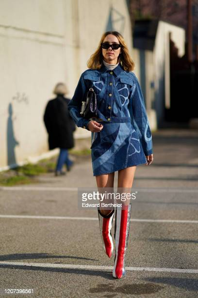 Candela Novembre wears sunglasses, a blue denim dress with printed patterns, a black bag, red white and black striped high boots, outside Alberta...