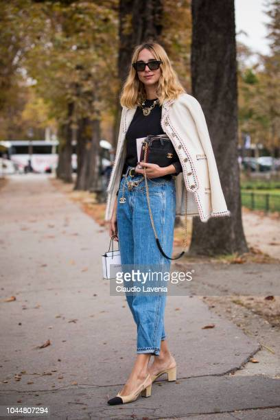 Candela Pelizza wearing a black top blue jeans with Chanel belt Chanel shoes black Chanel bag and nude jacket is seen after the Chanel show on...