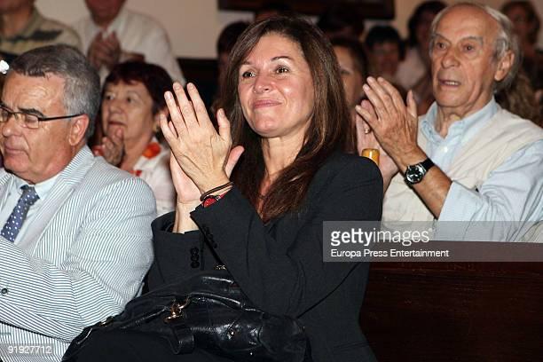Candela Tiffon applauds as singer Joan Manuel Serrat receives the Golden Medal Award from the city of Esplugues de Llobregat, at the Esplugues de...