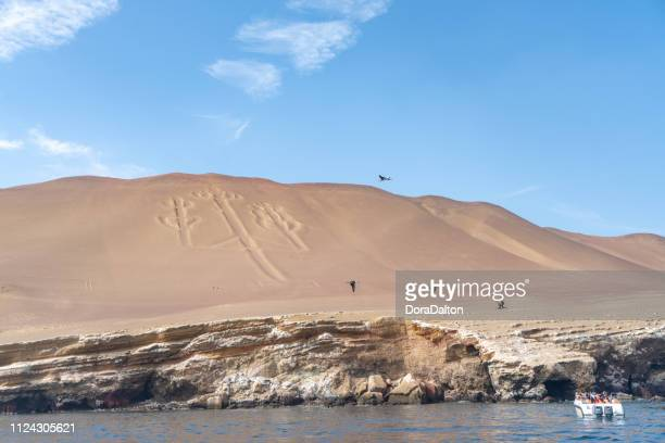candelabrum in paracas national park in paracas, peru. - pisco peru stock photos and pictures