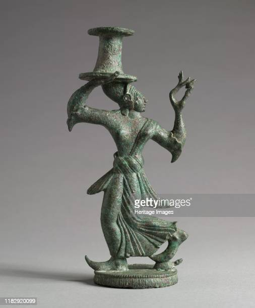 Candelabrum Stand of a Dancing Maenad, 525-500 BC. The woodland turtle beneath one of the maenad's feet identifies her. The work maenad means...