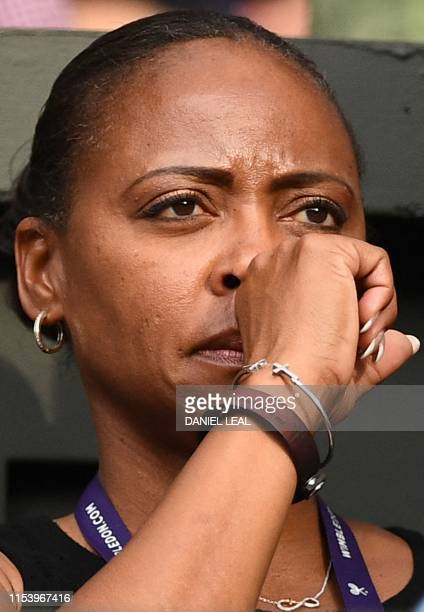 Candi Gauff mother of US player Cori Gauff reacts as she watches Guaff play against Slovenia's Polona Hercog during their women's singles third round...