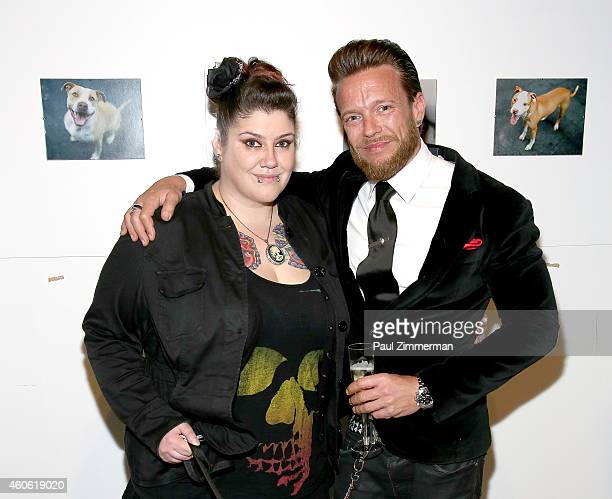 Candi McCarthy Herndon and photographer Jamie McCarthy attend a pet portrait exhibition by Getty Images staff photographer Jamie McCarthy to benefit...