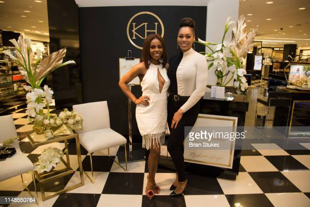 Candiace Dillard Bassett and Monique Samuels attend La'Dame Fragrance Popup at Bloomingdales on May 11 2019 in Tysons Corner Virginia
