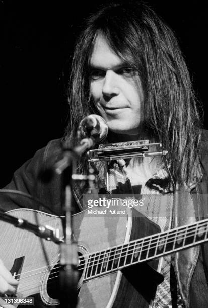 Candian singersongwriter Neil Young performs on stage at Hammersmith Odeon London 28th March 1976
