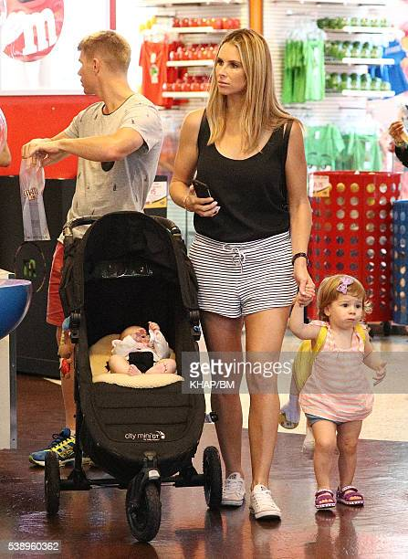 Candice and Dave Warner are seen exploring Times Square with their daughters Ivy Mae and Indi Rae on May 31 2016 in New York City