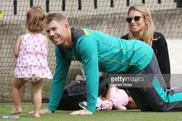 Candice and David Warner relax with their daughter Ivy during the Australian nets session at the on December 25 2017 in Melbourne Australia