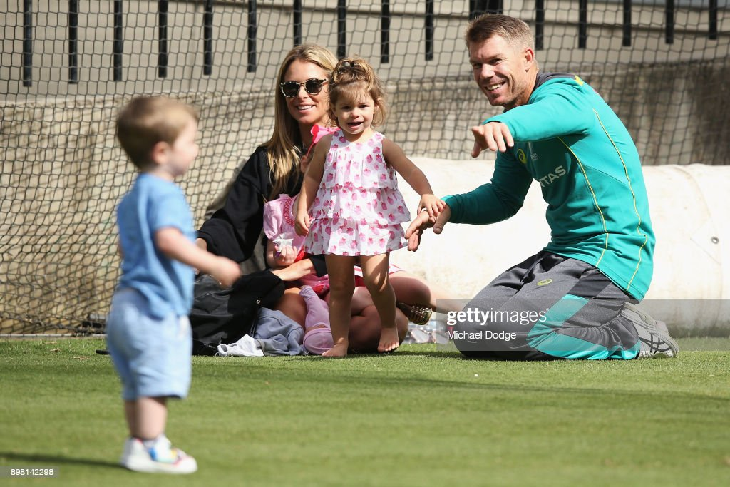 Candice and David Warner relax with their daughters Ivy and Indi during the Australian nets session at the on December 25, 2017 in Melbourne, Australia.