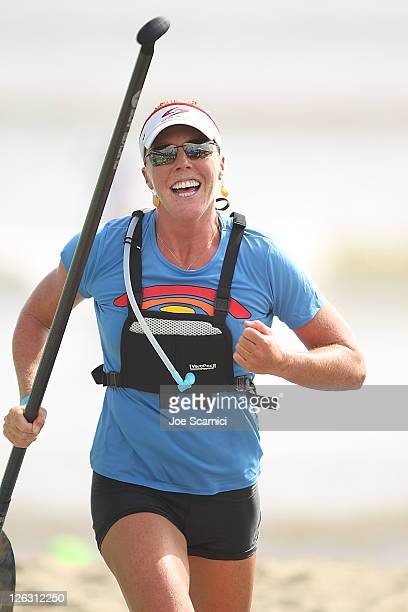 Candice Appleby of Hawaii celebrates after winning the womens final at the Battle Of The Paddle on September 24 2011 at Doheny Beach in Dana Point...
