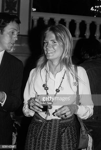 Candice Bergen holding a drink talking with a friend circa 1970 New York