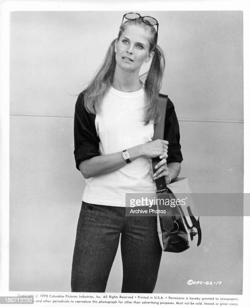 Candice Bergen holding handbag in a scene from the film 'Getting Straight', 1970.