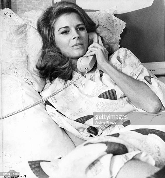 Candice Bergen on the phone in a scene from the film 'The Day The Fish Came Out' 1967