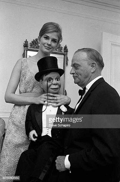 Candice Bergen pretends to strangle her father Edgar's ventriloquist dummy Charlie McCarthy