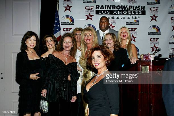 Candice Billings Janis Agopia Olivia Cham Cheryl Fisher Debbie Simmons Earvin 'Magic' JohnsonSharon Hicks and Cerise Feely attend the Rainbow...