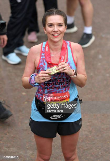 Candice Brown poses with her medal after completing the Virgin London Marathon 2019 on April 28, 2019 in London, United Kingdom.