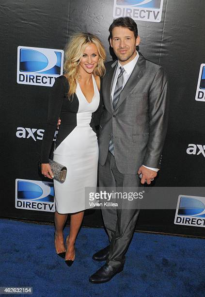 Candice Crawford and football player Tony Romo attend DIRECTV Super Saturday Night Arrivals at DIRECTV SuperFan Stadium on January 31 2015 in Phoenix...