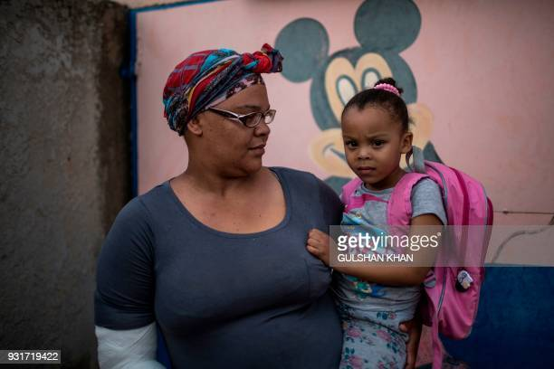 Candice du Preez carries her daughter who was one of the nine children infected with Listeriosis at the Childrens Orientation Centre in Klipspruit...
