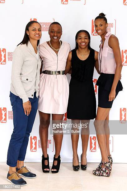 Candice Dupree Charde Houston Jasmine James and DeWanna Bonner of the Phoenix Mercury pose for a picture at the 2013 WNBA Inspiring Women's Luncheon...