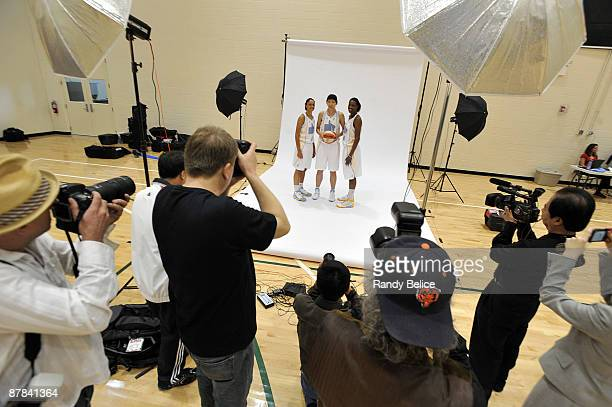 Candice Dupree Chen Nan and Sylvia Fowles of the Chicago Sky pose for a pictures during the team's WNBA Media Day on May 18 2009 at the Attack...